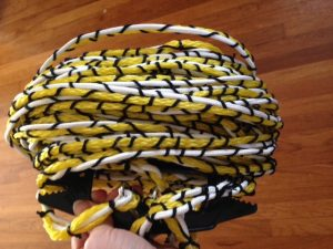 Coils of thin rope in white, yellow, and black